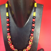 Chunky black, red and yellow African glass bead necklace