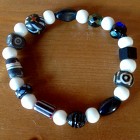 stretchy black and white bracelet with collection of unusual and vintage beads