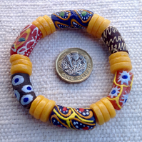 "6.5"" African bead bracelet with golden yellow disks and multicolour beads"