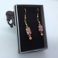 White earrings with modern African glass trade beads