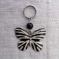 Keyring with vintage butterfly pendant, black and cream