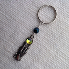 Keyring with a vintage enchanted tower pendant
