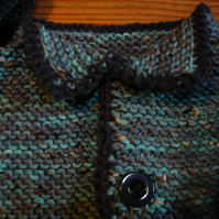 A baby boy's cardigan and hat