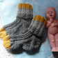 "100% alpaca handknitted grey yellow baby socks  4""sole up to 12 months"