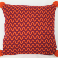 Knitted cushion - red and orange felted wave design
