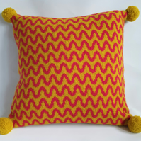 Knitted cushion - mustard and red felted wave design