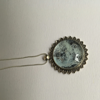 Artist created blue and grey pendant in silver coloured metal fixing and chain