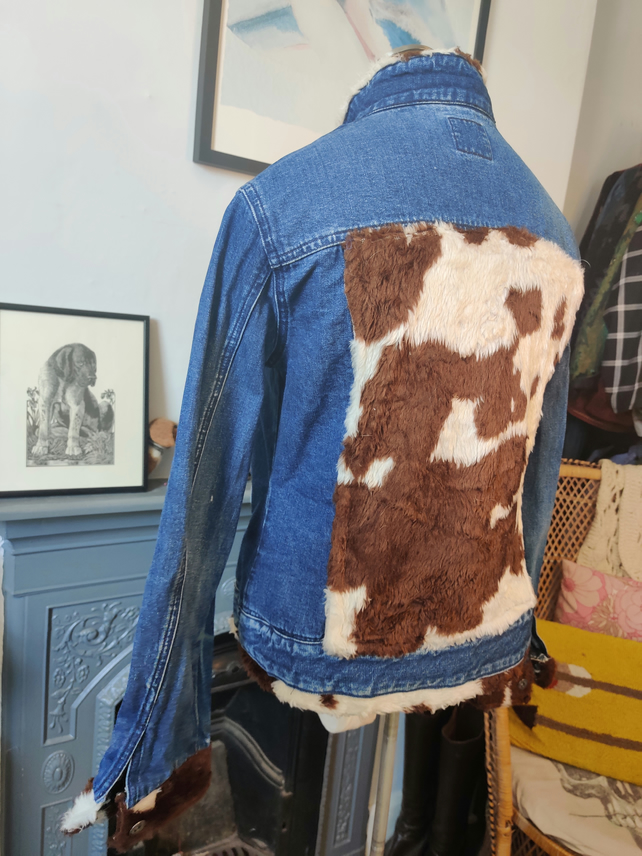 Upcycled 90s Trader denim jacket with vintage cow print faux fur.