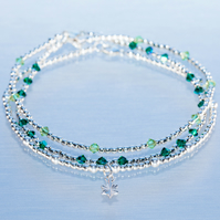Sterling silver stacking bracelets with green swarovski and star charm