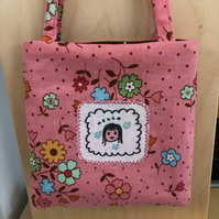 "Small pink bag with ""hello"""