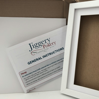 White box frame for Jiggery Pokery embroideries with mounting card