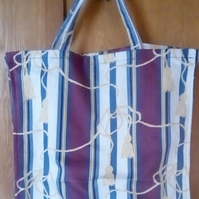 tote bag with yellow tassel design
