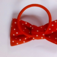 Red fabric bow on elstic band