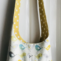 Sling bag reversible with birds.