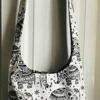 Reversible sling bag With Elephants