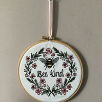 Bee Kind embroidered hoop decoration.