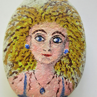 Girl painting. Rock painting. Stone art.