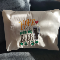 embroidered home is where the beer is cushion
