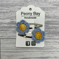 Girl's hair clips, pair of blue and yellow flower clips