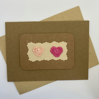 Card with 2 crochet hearts in pink, blank card