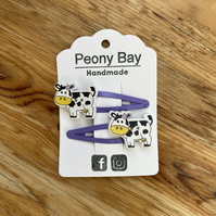 Girl's purple hair clips with cows
