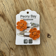 Girl's hair clips, pair of flower clips in bright orange