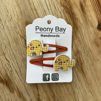 Hair clips with elephants in yellow & orange