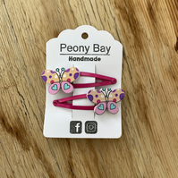 Girl's butterfly hair clips in pink