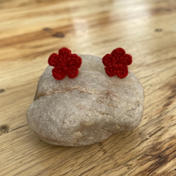 Red flower earrings on hypoallergenic surgical steel studs