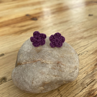 Purple flower earrings on hypoallergenic surgical steel studs
