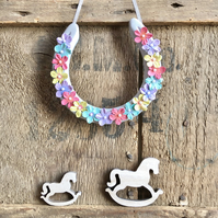 Decorated horseshoe fun multicoloured flowers