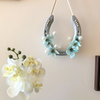 Decorated horseshoe mint blue flowers and pearls