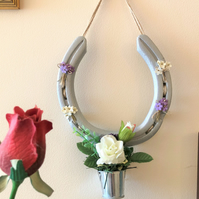 Decorated horseshoe hanging flower bucket