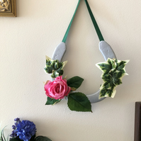 Decorated horseshoe rose and ivy