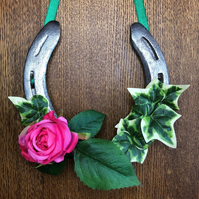 Decorated horseshoe pink rose and ivy