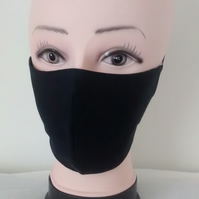 Handmade 3 layers black reusable adult face mask.