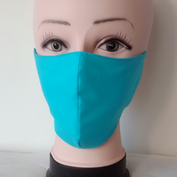 Handmade 3 layers turquoise reusable adult face mask.