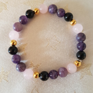 Healing bracelet for loss made with 8mm gemstones. Infused with Reiki....