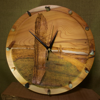 Hand made yew wood wall clock with Ring of Brodgar artwork.