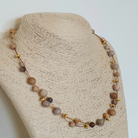 Fossilised coral and gold coloured haematite necklace with toggle clasp