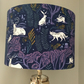 Woodland creatures lampshade handmade in blue,white and purple.