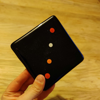Polka-dot Diagonal Line Coaster - black background