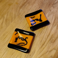 Pair of Orange, Black and Dark Blue Candle Dishes