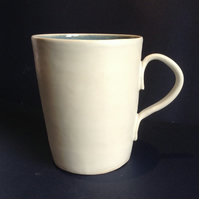Hand thrown tall blue and white ceramic mug