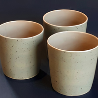 Handleless grey stoneware ceramic mug