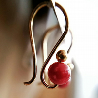 Small gold drop earrings with dark red burgundy bead