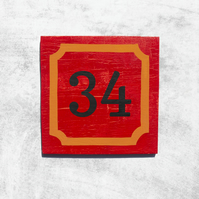 Red and Cracked Orange House Number Sign