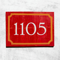 Red and Cracked Orange House Number Rectangle Sign