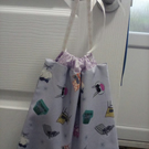 60's style cats on chairs lilac drawstring bag