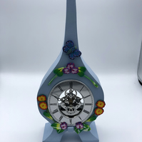 Clock in Painted oak, polymer clay flower decoration, skeleton works.
